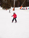 Small girl skiing Stock Images