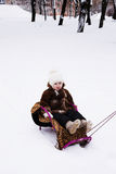 Small girl in a sled Royalty Free Stock Image