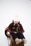 Small girl in a sled Stock Photography