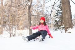 Small girl sliding from hill fast. Stock Image