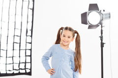 Small girl smiles charmingly during shooting Stock Photography