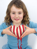 Small girl smiling and holding a valentine heart Stock Photo