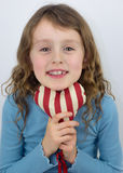 Small girl smiling and holding a valentine heart Royalty Free Stock Images