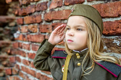 Small girl in Soviet military uniforms Royalty Free Stock Photo