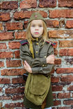 Small girl in Soviet military uniforms Stock Photo