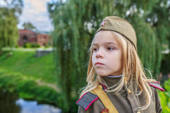 Small girl in Soviet military uniforms Stock Photography