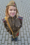 Small girl in Soviet military uniforms Royalty Free Stock Image