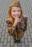 Small girl in Soviet military uniforms Royalty Free Stock Images
