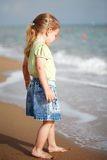 Small girl standing on beach Royalty Free Stock Photography