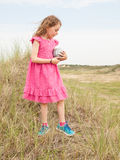 Small girl standing in a dune landscape Royalty Free Stock Photo