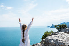 Small girl stay on the top of mountain stock image
