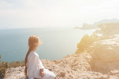 Small girl stay on the top of mountain stock images