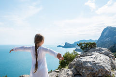 Small girl stay on the top of mountain royalty free stock images
