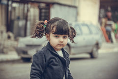 Small Girl in street Stock Images