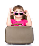 Small girl with sunglasses and suitcase. isolated on white Stock Image