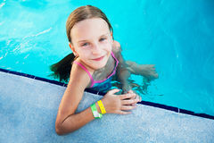Small girl at the swimming pool. Royalty Free Stock Images