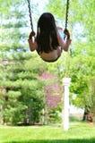Small girl swinging Stock Photography