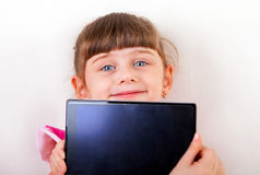 Small Girl with Tablet Computer Royalty Free Stock Photography