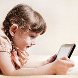 Small Girl with Tablet Computer Royalty Free Stock Images