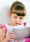 Small Girl with Tablet Computer Royalty Free Stock Photo