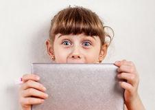 Small Girl with a Tablet Stock Images