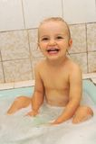 Small girl taking bath Stock Image
