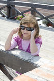 Small girl talking to a mobile phone Royalty Free Stock Photography