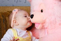 Small girl and toy bear royalty free stock images