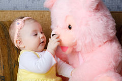 Small girl and toy bear Royalty Free Stock Photo
