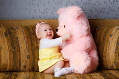 Small girl and toy bear Stock Photography