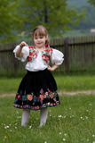 Small girl in traditional dress on the meadow Stock Photo