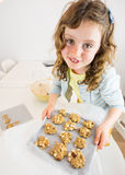 Small girl with tray of unbaked cookies Stock Photography