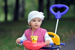 Small girl with tricycle Royalty Free Stock Image