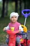 Small girl with tricycle. Close up Royalty Free Stock Images