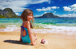 Small girl on the tropical beach Royalty Free Stock Images