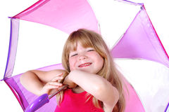 Small girl under umbrella Royalty Free Stock Photos