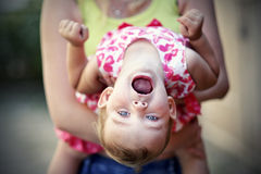 Small girl upside down Stock Image