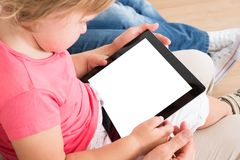 Small girl using digital tablet Royalty Free Stock Photos