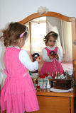 Small girl using make-up Stock Images