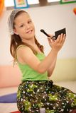 Small girl using makeup Royalty Free Stock Photography