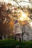 Small girl walking in a park Royalty Free Stock Images