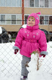Small girl walking in winter Royalty Free Stock Image