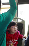 Small girl watching tv on the bus Stock Images