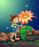 A small girl watering the giant plant Royalty Free Stock Photos