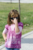 Small girl wearing dark sunglasses Royalty Free Stock Photography