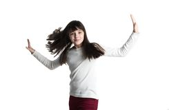 The Small girl in white gown spins, jumps, playing, smiling,  pose Royalty Free Stock Photos