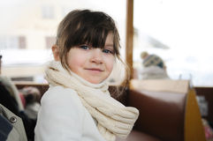 Small girl in winter clothes in old style train Royalty Free Stock Images
