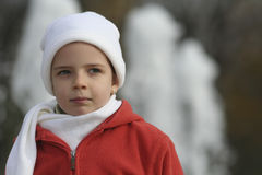 Small girl in winter clothes Stock Photo