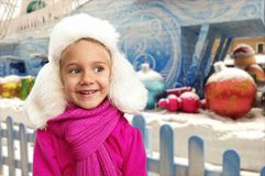 Small girl in winter interior Stock Image