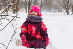 Small girl among winter trees Stock Photo